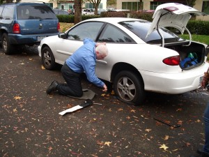 Jeff helps new employee with flat tire.